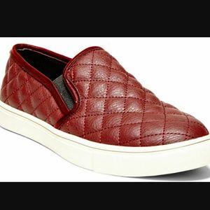 Steve Madden burgundy slip on sneakers.